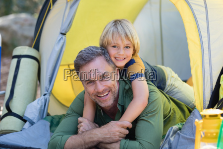 little boy lying on father in
