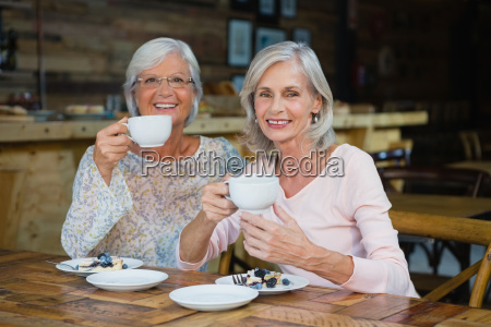 portrait of senior friends having coffee