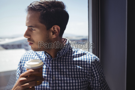 close up of thoughtful businessman holding