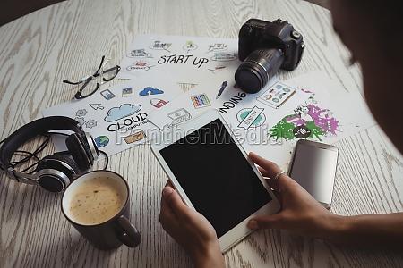 businesswoman using digital tablet at creative