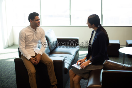 businessman ineracting with female colleague in