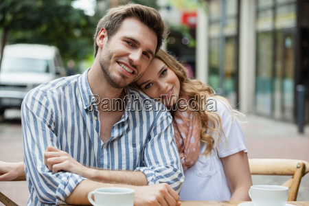 portrait of romantic couple sitting at
