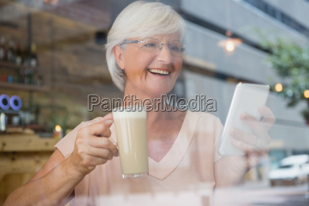 happy senior woman using mobile phone