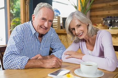 portrait of senior couple sitting in