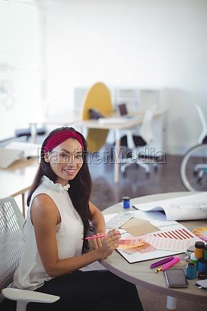 portrait of smiling entrepreneur working in