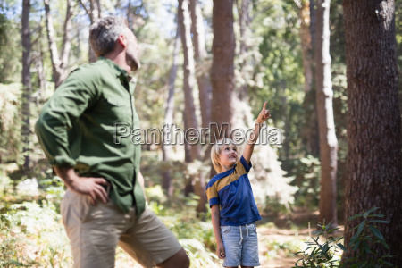 little boy showing something to father