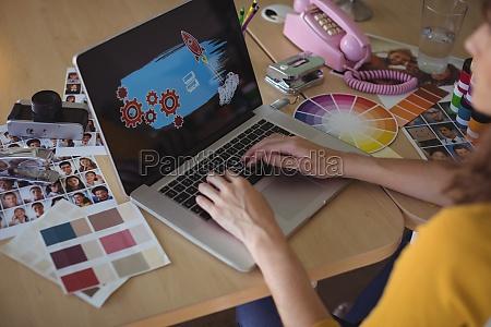 graphic designer working on laptop at
