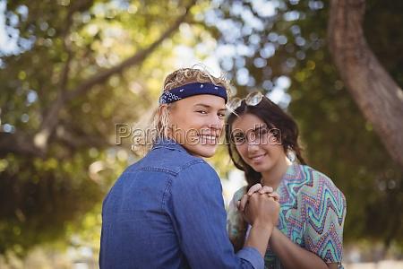 portrait of romantic couple holding hands