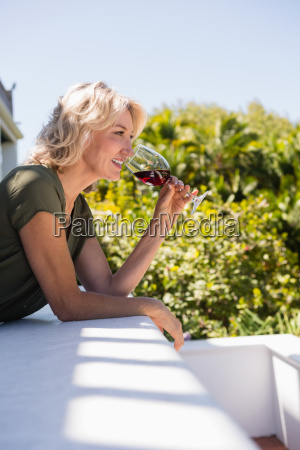 mid adult woman drinking red wine