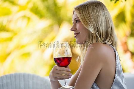 beautiful woman holding red wine glass