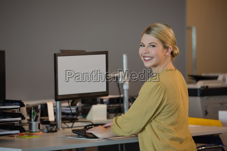 portrait of smiling executive working at