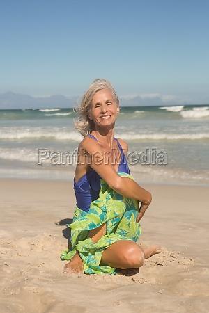 portrait of smiling woman practising yoga