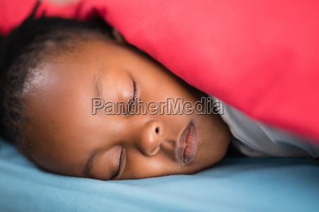 close up of girl sleeping on