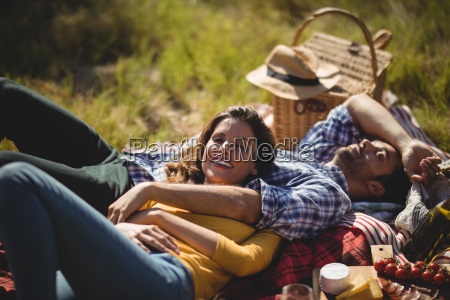 smiling young woman with boyfriend relaxing