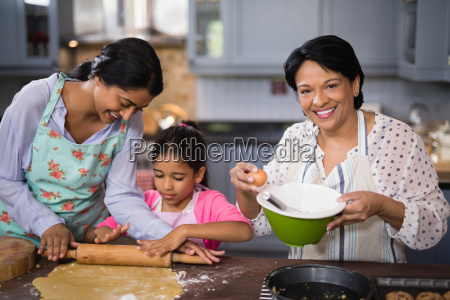 portrait of woman preparing food with