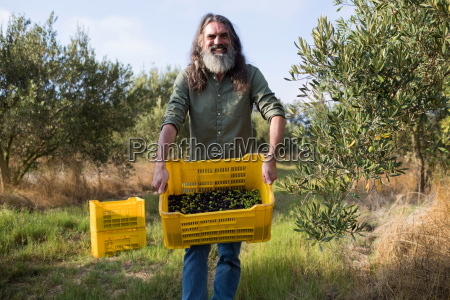 portrait of happy man holding harvested