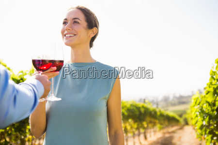 smiling young woman toasting wineglass with