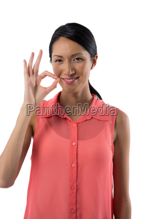 smiling woman gesturing okay hand sign