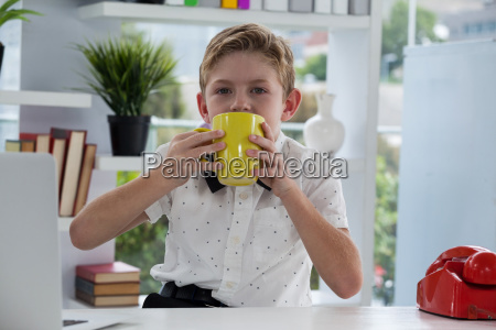 portrait of businessman drinking coffee from