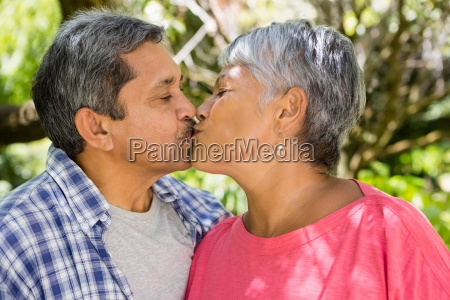 senior couple kissing each other in