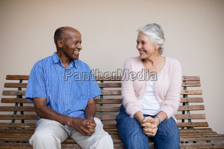 smiling senior man and woman looking