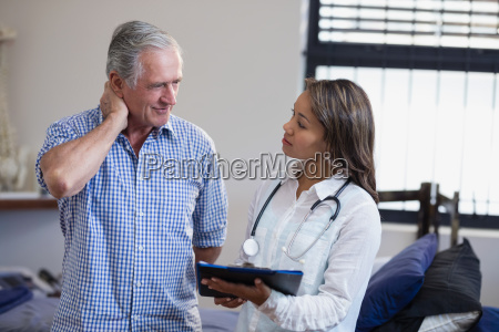 senior male patient and female therapist