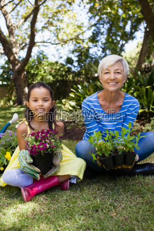 portrait of smiling granddaughter and grandmother