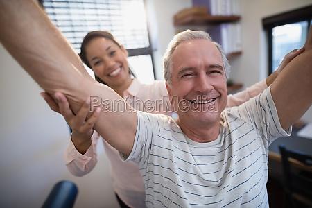 portrait of smiling senior male patient