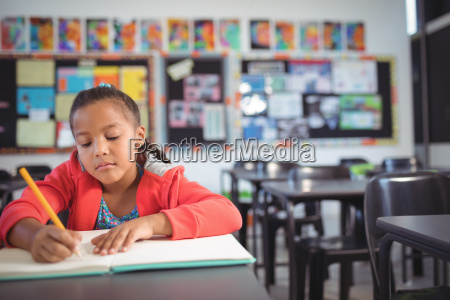 girl studying while sitting at desk