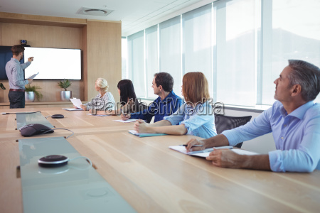 business people at conference table during