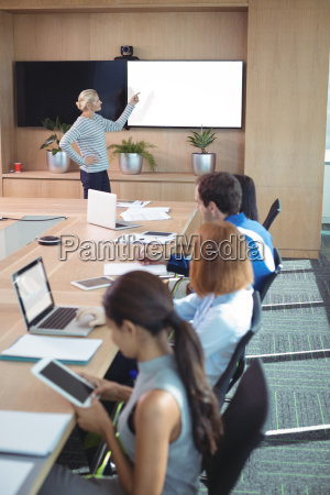 colleagues at conference table during business