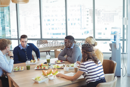 business people having lunch at office