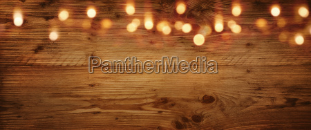 wooden background with golden light effects