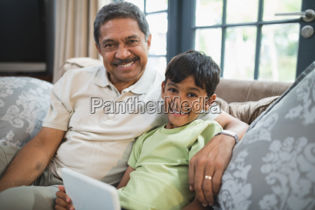 portrait of smiling boy with grandfather