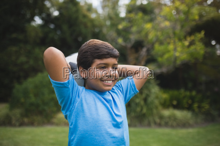 smiling boy holding soccer ball at