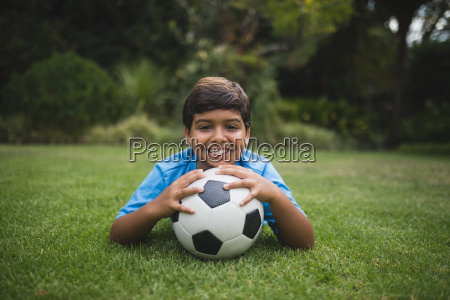 portrait of smiling boy with soccer