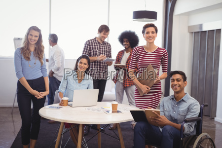 smiling business team with handicap colleague