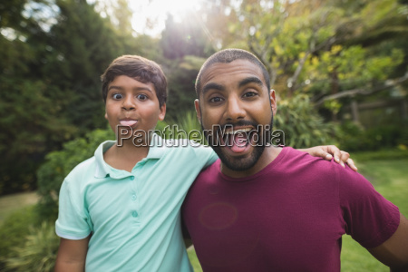 mischievous father and son enjoying at