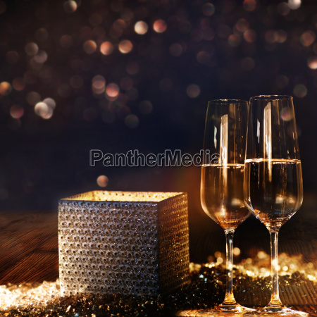 bright radiant gift box with champagne