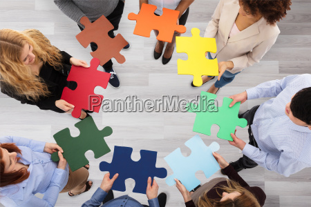 group of business people holding colorful