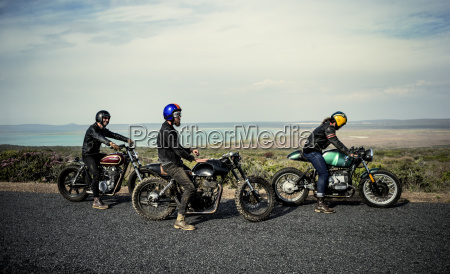 three men wearing open face crash