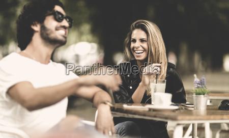bearded man wearing sunglasses and woman