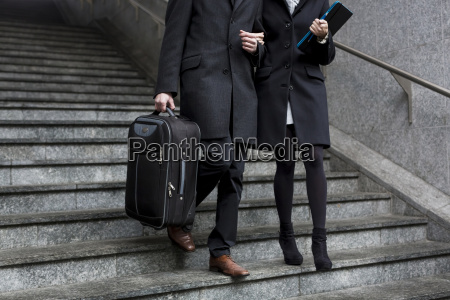 business couple in the city walking