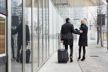 businessman and businesswoman walking in the