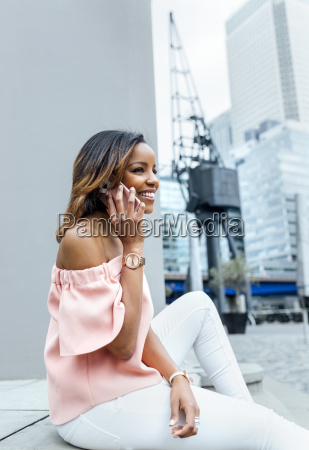 smiling woman talking on the phone