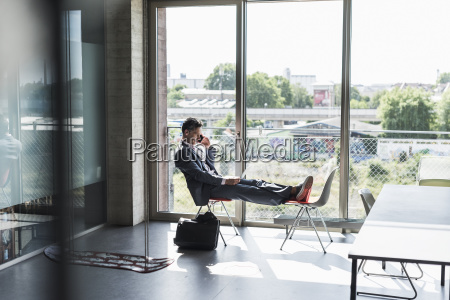 businessman sitting at the window with