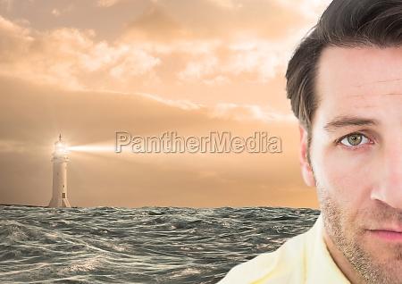 trauriger mann neben dem hoffnungsvollen leuchtturm