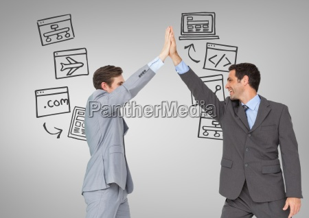 businessmen high five with technology screens