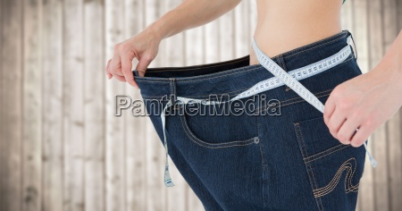 woman with large pants and measuring