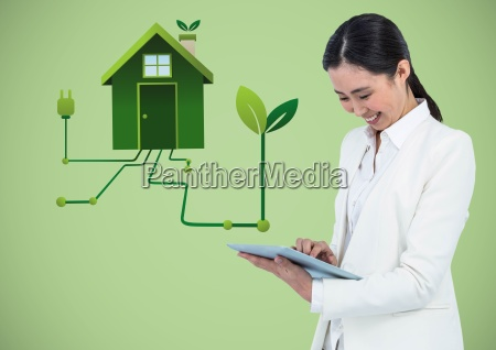 woman with tablet and green house